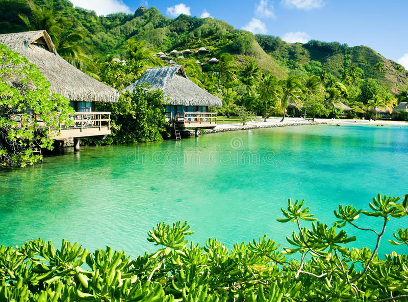 Over water bungalows and a green lagoon. Over water bungalows and an amazing green lagoon royalty free stock photos
