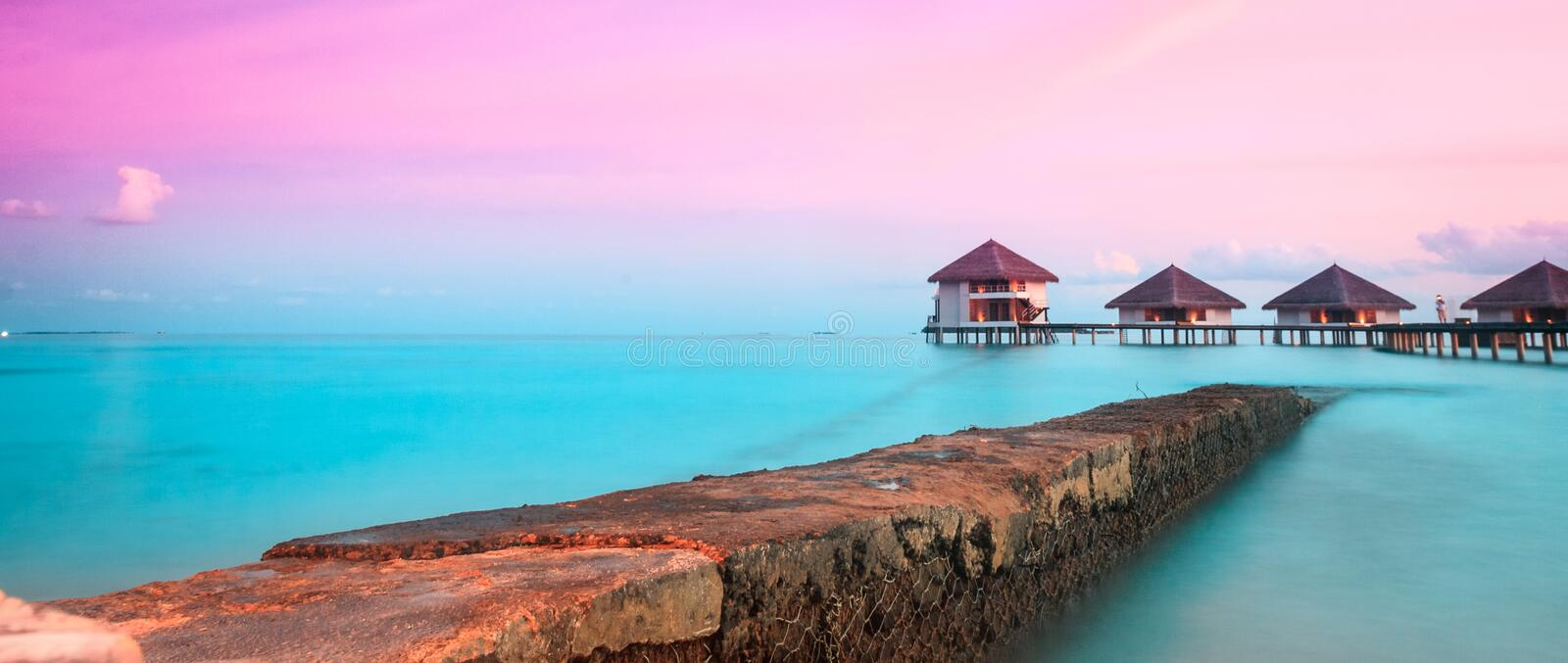 Over water bungalows. With steps into amazing green lagoon royalty free stock images