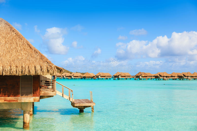 Over water bungalows with steps into amazing green lagoon royalty free stock photos