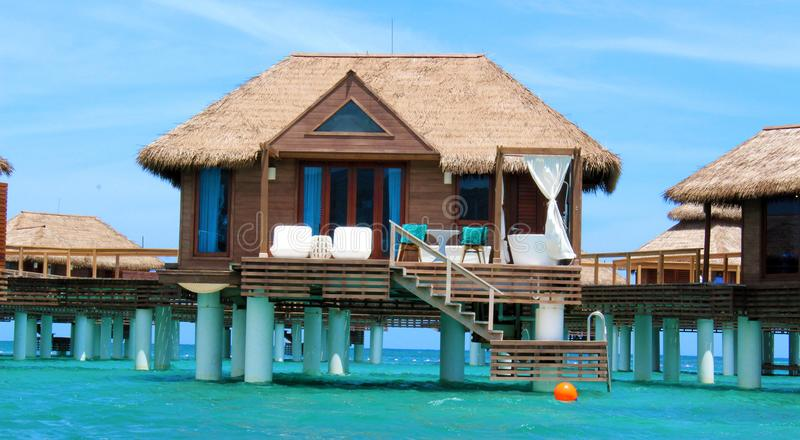 Over the water luxury bungalow jamaica maldives stock for Luxury bungalow designs