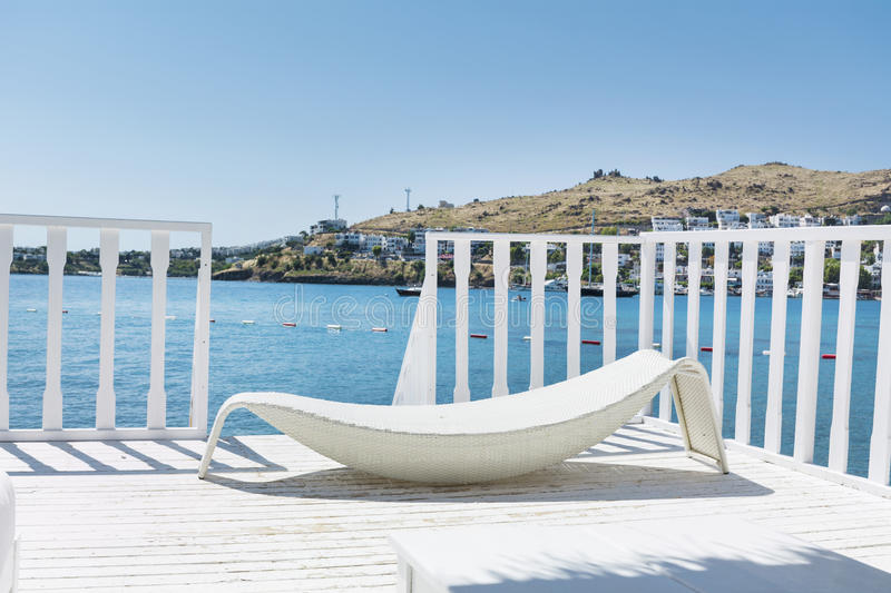 Over water wooden bungalow with white sunbed stock images
