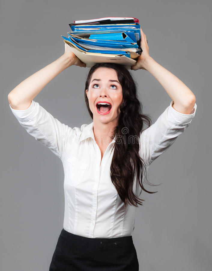 Over worked business woman stock photo