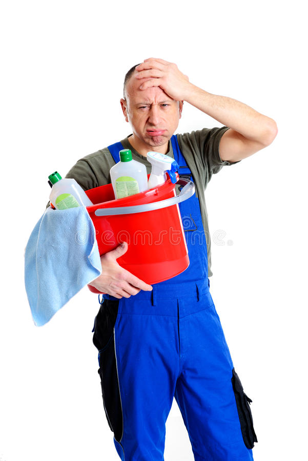 Over-worked professional cleaner. Young over-worked professional cleaner in front of white background stock image