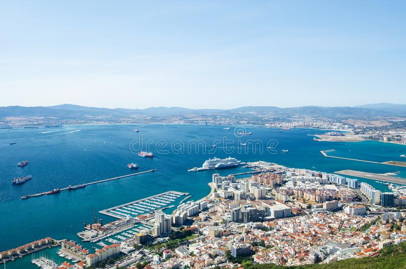 Overall view from top of the Rock of Gibraltar city, cruise port and marina, airport runway, Gibraltar Bay or Bay of Algeciras. royalty free stock photography