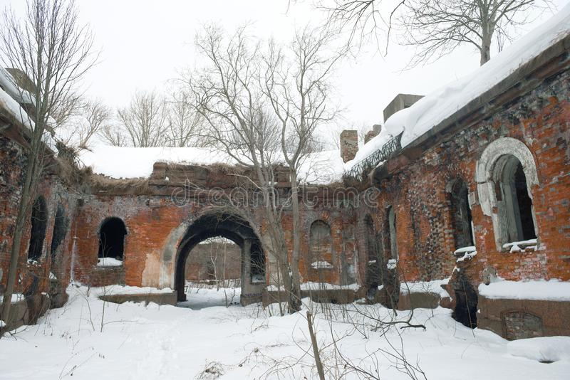 Overcast February day in the courtyard of the abandoned artillery fort `Zverev` Northern Fort No. 4. Kronstadt. Russia stock photography