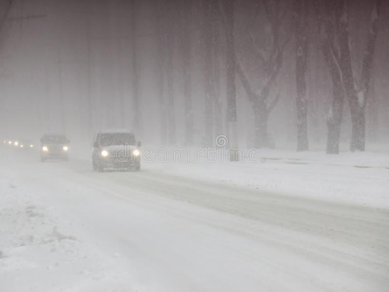 Overcast. Natural disasters winter, blizzard, heavy snow paralyzed city car roads, collapse. Snow covered cyclone.  stock image