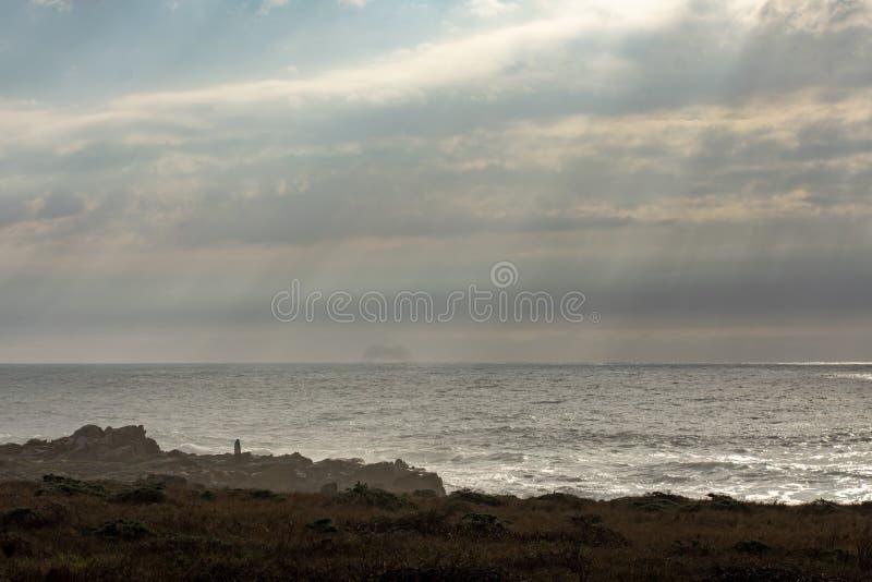Overcast ocean sky. Pacific coast ocean and overcast sky stock photos