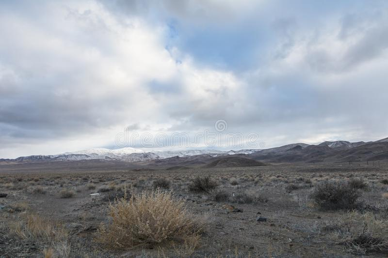 Overcast sky above snowcapped mountain. In Nevada, USA royalty free stock photography
