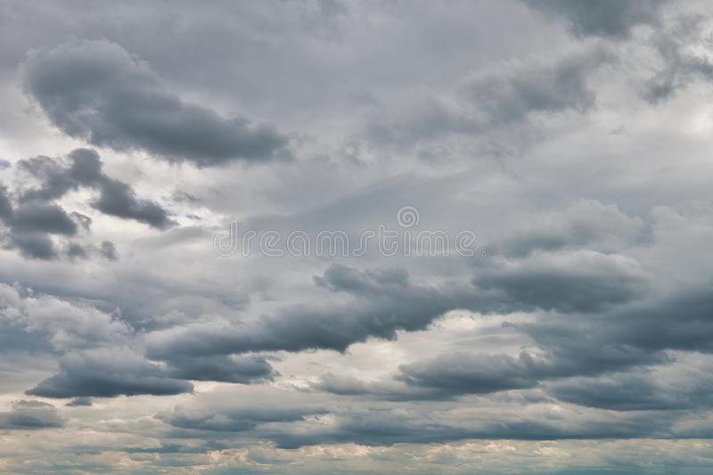 Overcast sky with dark clouds. The gray cloud, before rain royalty free stock photo