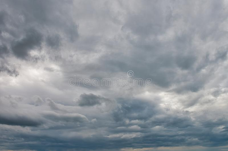 Overcast sky with dark clouds. The gray cloud, before rain royalty free stock photography