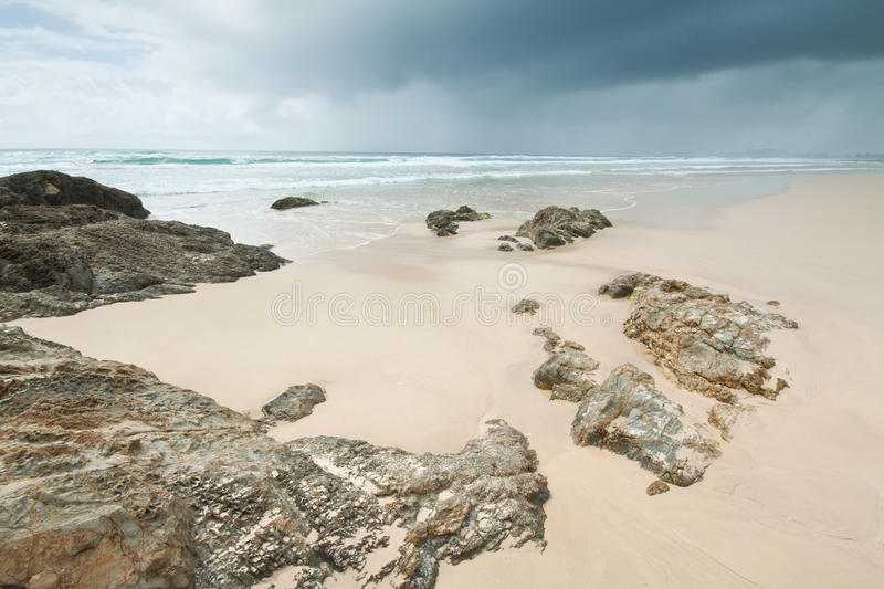 Overcast sky over beautiful beach during the day. (currumbin beach,gold coast,queensland,australia royalty free stock image