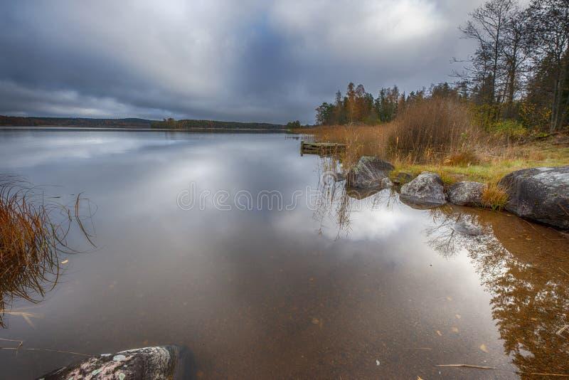 Overcast sky over lake. Lake Harefjorden in Sweden, near Säffle and  lake Vänern in Sweden royalty free stock photo