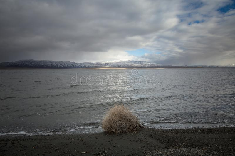 Overcast sky over snowcapped mountains royalty free stock photo