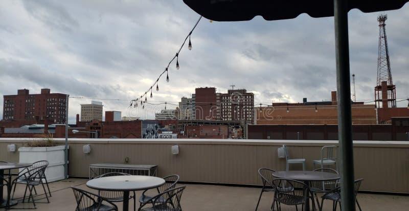 The Overcast Sky of an Overcast City. Canto, ohio, rooftop, skyline, building, buildinga, buildings, chaira, chairs, tables, restaurant, lighta, lights royalty free stock photos