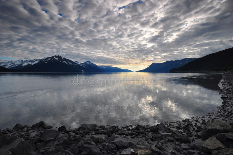 Overcast sky reflecting on water. At Turnagain Arm, Alaska stock image
