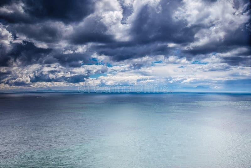 Overcast weather over sea stock photography