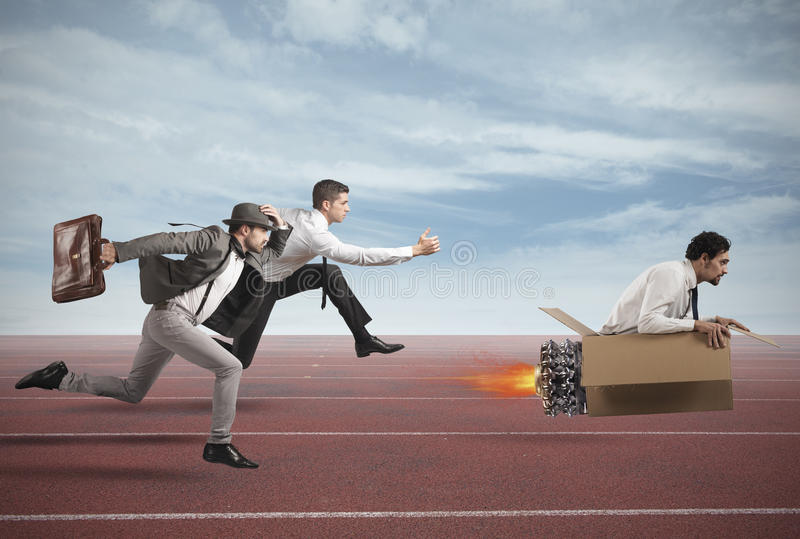 Overcome and achieve success. Businessman with cardboard missile overcomes and wins a race against opponents royalty free stock photos