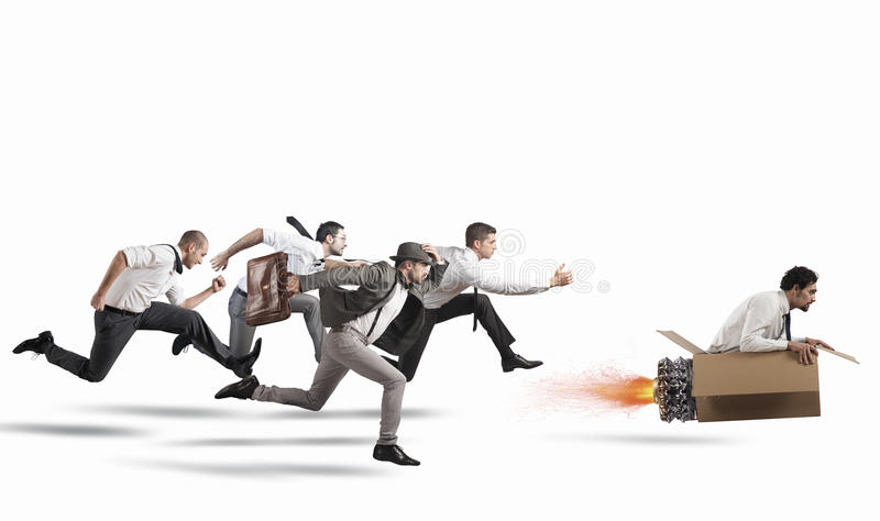Overcome and achieve success. Businessman with cardboard missile overcomes and wins a race against opponents royalty free stock images