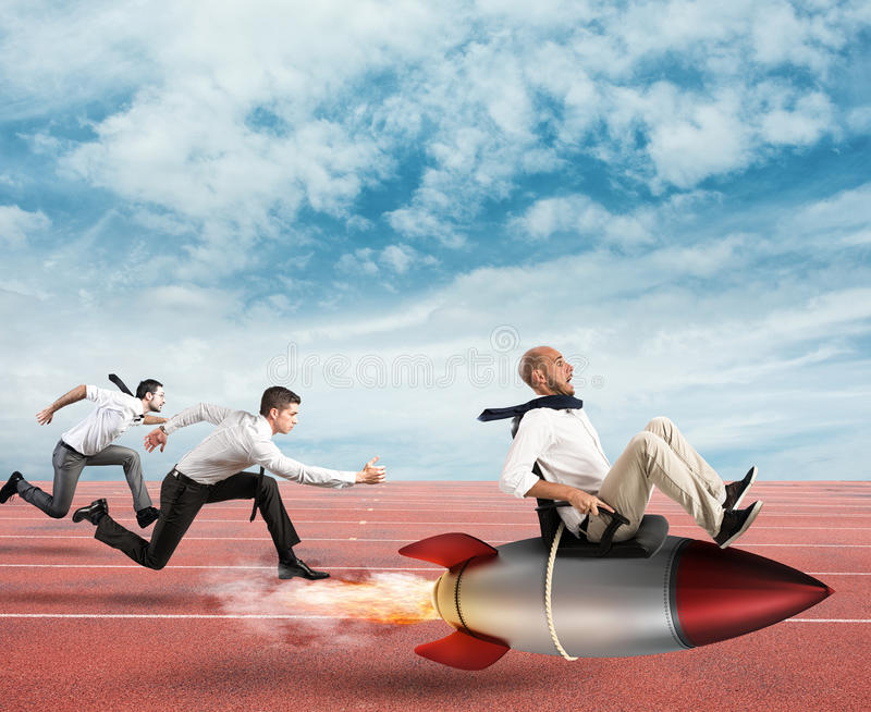 Overcome and achieve success. Businessman fly with rocket during a race with opponents stock photography