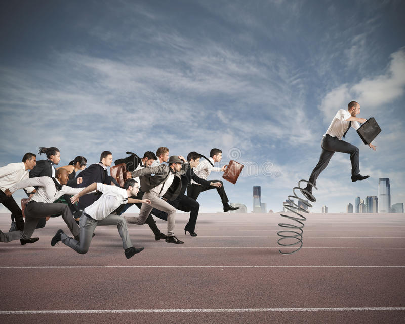 Overcome and achieve success. Businessman jumping on a spring during a race with opponents royalty free stock photography