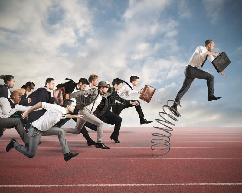 Overcome and achieve success. Businessman jumping on a spring during a race with opponents stock photos