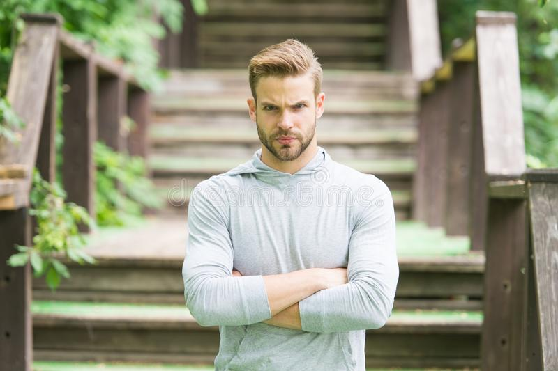 Overcome any obstacles. Sportsman lifestyle. Handsome athlete stairs background. Male beauty. Sport wellbeing and self. Care. Handsome man sporty outfit look royalty free stock images