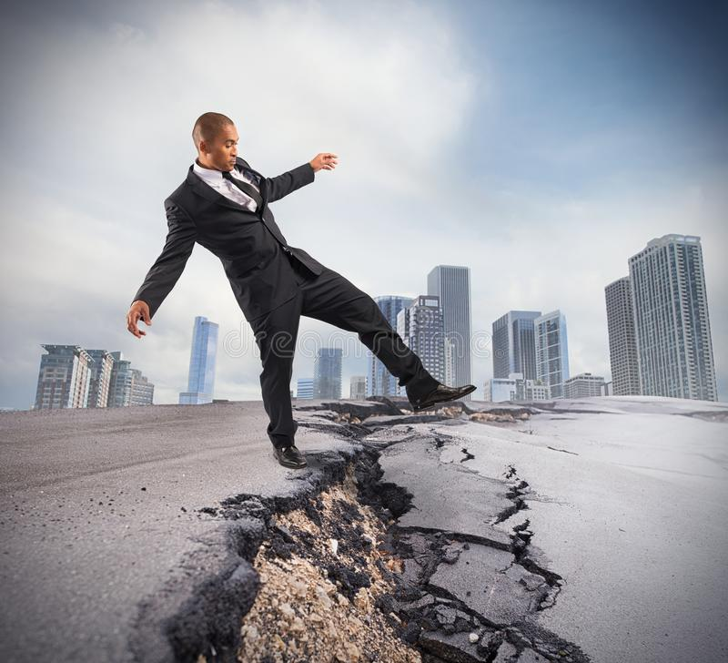 Overcome a crisis break. Businessman trying to overcome a crisis break royalty free stock images
