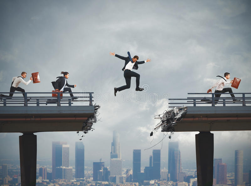 Overcome obstacles in career. Business people overcome a broken bridge with a big jump royalty free stock images