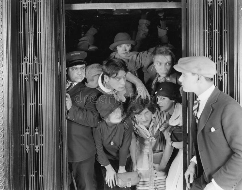 Overcrowded elevator. (All persons depicted are no longer living and no estate exists. Supplier grants that there will be no model release issues stock image