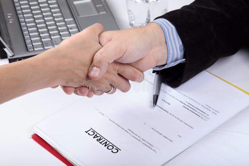 Overeenkomst. Handdruk stock foto