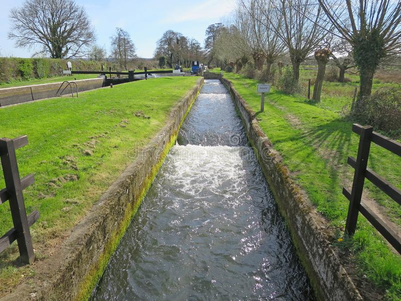 Overflow weir at Triggs Lock. On the River Wey Navigation near Woking, Surrey, England stock photos