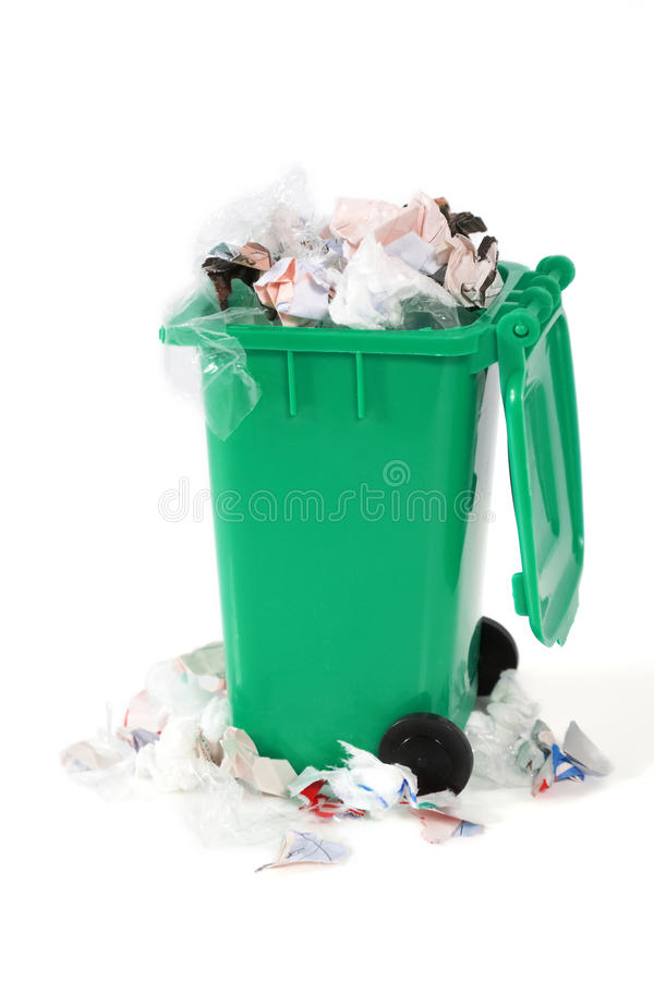 Overflowing garbage bin stock image