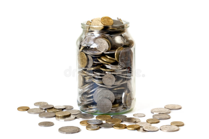 Overflowing Jar of Coins. Overflowing jar of Australian coins, isolated on white