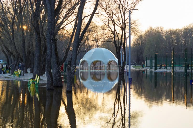 Flooded park, beach and UFO-shaped bar stock photography