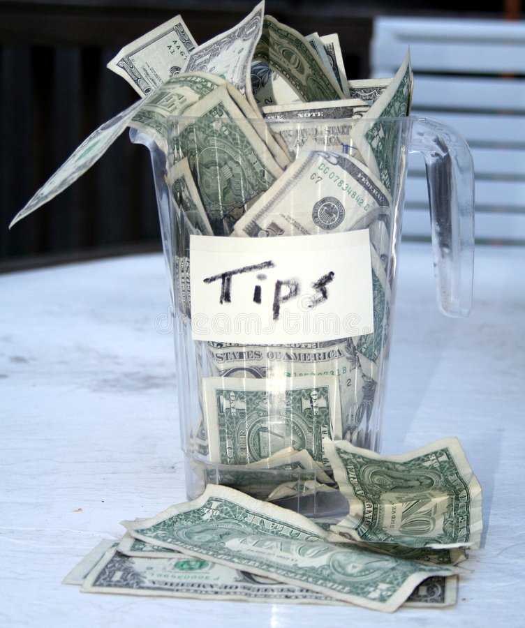 Overflowing Tip Cup Royalty Free Stock Image