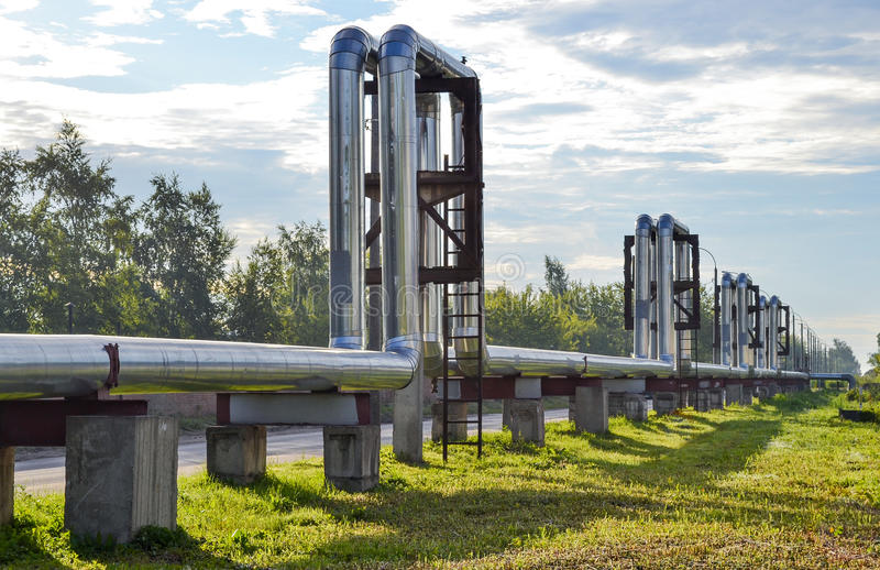 Overground heat pipes. Pipeline above the earth conducting heat for heating city stock photos