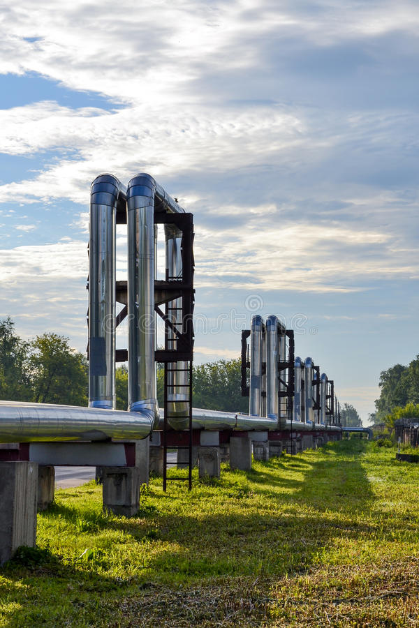 Overground heat pipes. Pipeline above the earth conducting heat for heating city stock image
