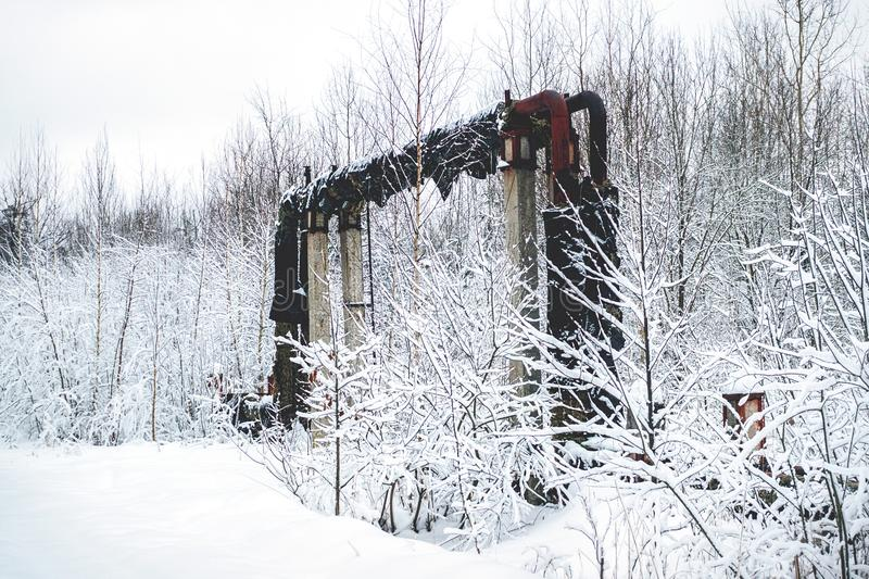 Overground heat pipes. Pipeline above ground, conducting heat for heating the city. Winter. Snow stock images