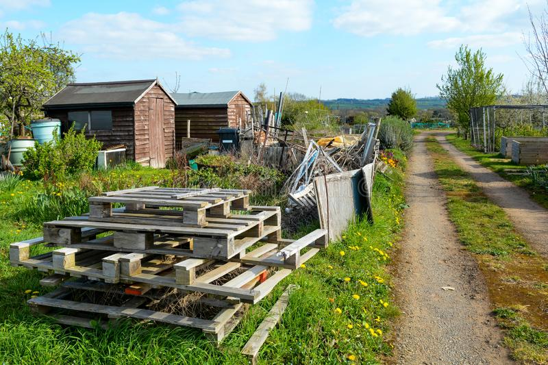 Run down rural land. Overgrown plot of land with scrap materials in foreground stock photo