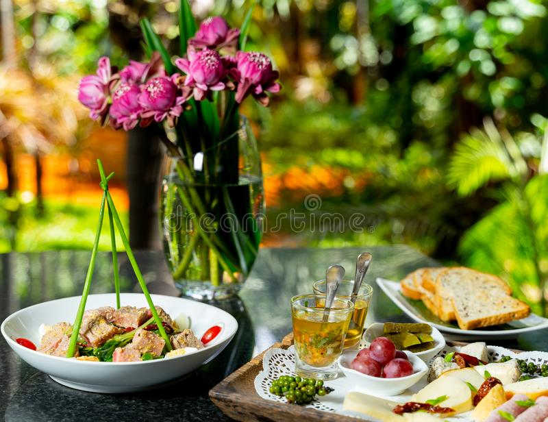 Overhead of cheese platter with crispy toasts stock photography
