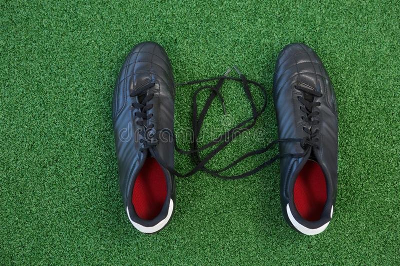 Cleats on artificial grass. Overhead of cleats on artificial grass stock photos