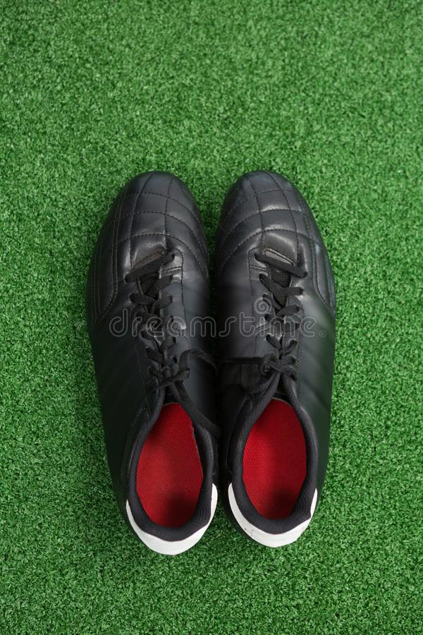 Cleats on artificial grass. Overhead of cleats on artificial grass stock image