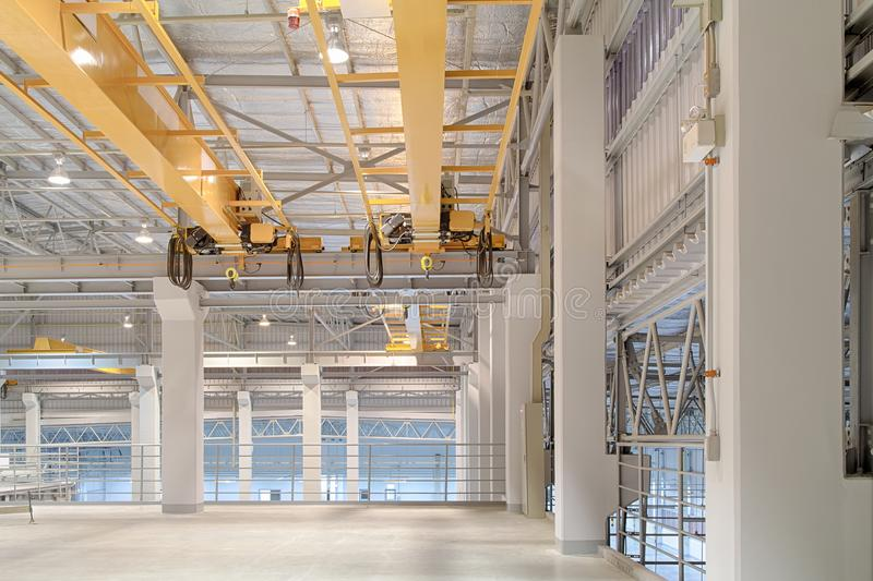 Overhead crane factory. Overhead crane and concrete floor inside factory building for background royalty free stock photos
