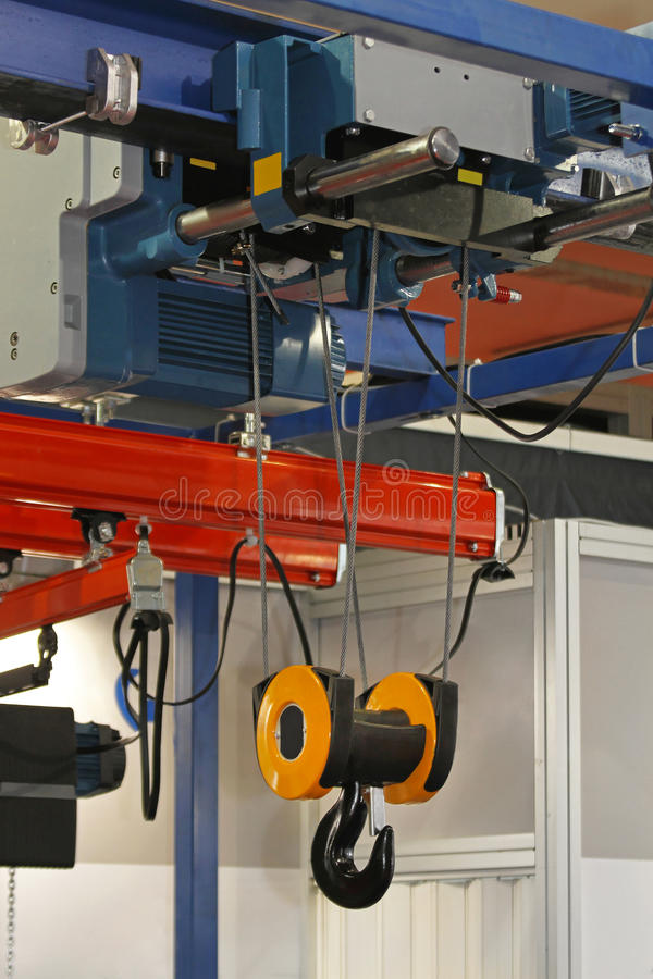 Overhead crane. And hoist device mounted on a trolley at beam royalty free stock photos