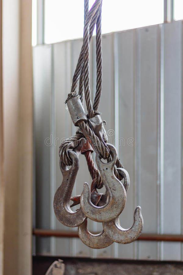 Overhead crane hooks closeup in the assembly workshop royalty free stock photography