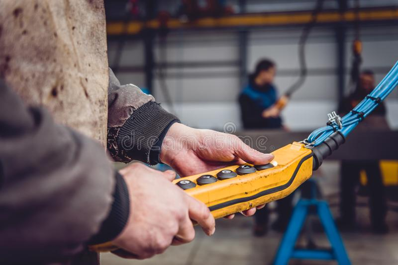 Overhead Crane Operator. In big industrial hall royalty free stock images