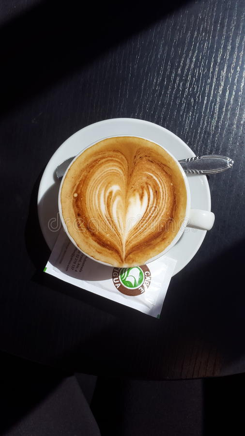 Overhead on cup of cappuccino stock images