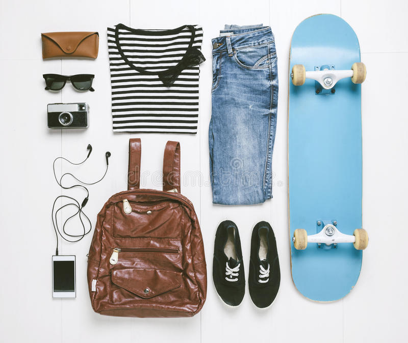 Overhead of essentials skater woman. stock photos