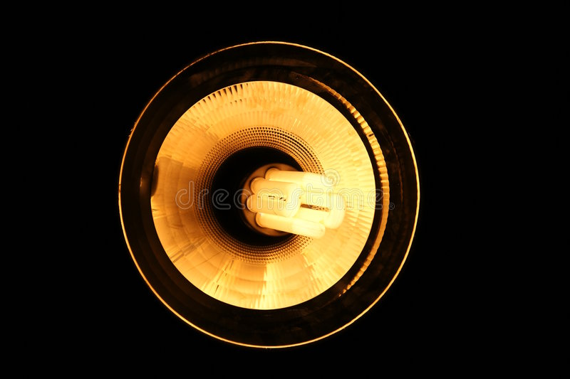 Overhead Fluorescent Lamp. On dark background stock photography