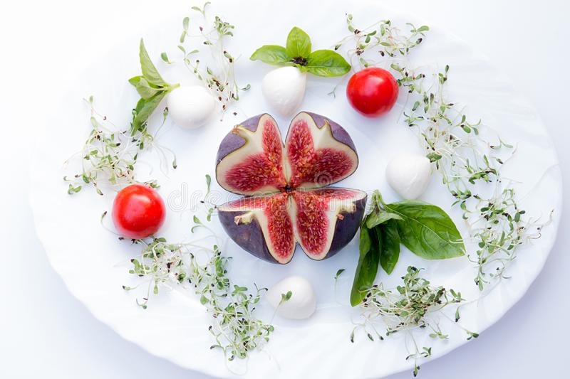 Overhead of food composition with fig, tomato cherry, mozzarella stock photos